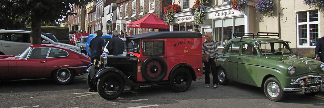 Club members and their vehicles at Hungerford Antiques Arcade